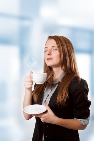 inhale: Businesswoman to inhale aroma coffee Stock Photo