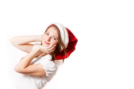 santa clause hat: Young girl smiling in Santa Clause hat