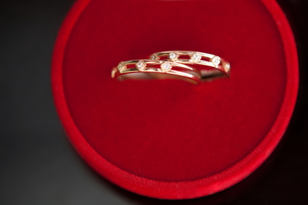 wedding rings in a box on a gray background photo