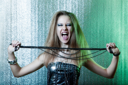 Beautiful girl with metal fetters photo