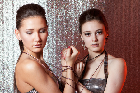 sadism: Beautiful girls with metal fetters