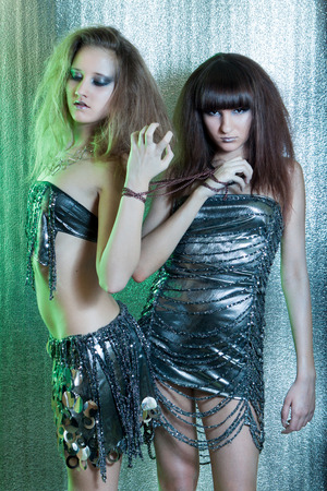 Beautiful girls with metal fetters photo