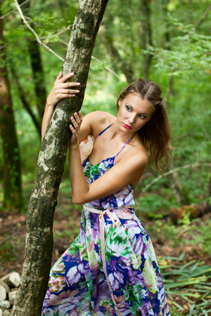 Pretty young girl in the forest photo