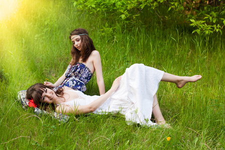 Pretty young girls on the meadow photo