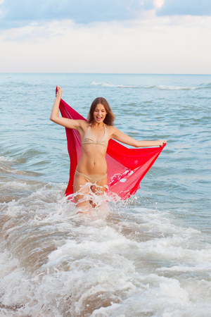 Young woman in a pareo on the sea photo