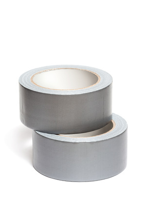 Rolls of white adhesive tape, isolated on white background photo
