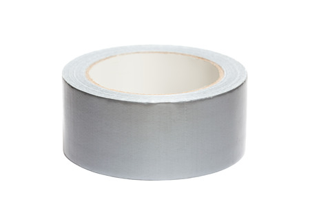 Roll of white adhesive tape, isolated on white background photo