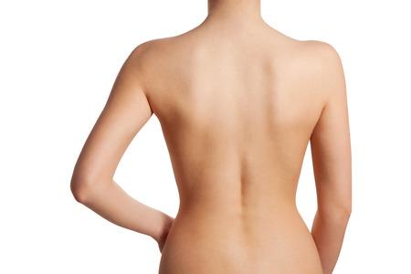 Schöne und nackte weibliche Rückansicht, isoliert auf weißem Hintergrund