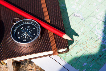map pencil: Notebook, compass, pencil on old stone background
