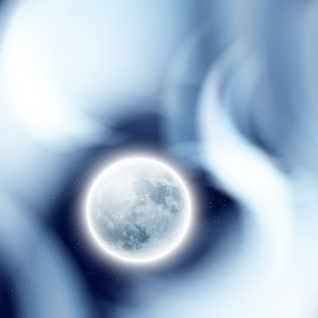 astro: Full moon in the night sky with clouds.