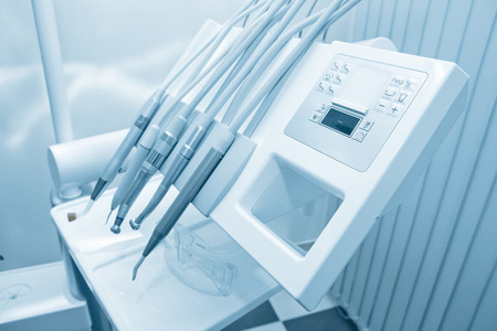 Tools of dentist in a dentist office. Blue tone. Stock Photo