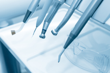 Tools of dentist in a dentist office. Blue tone. Archivio Fotografico