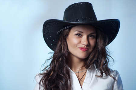 Smiling woman with cowboy hat