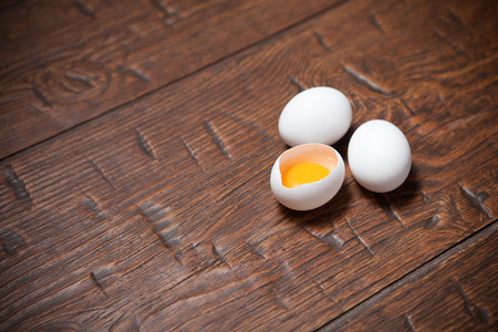 jaded: Fresh farm eggs on a wooden rustic table Stock Photo