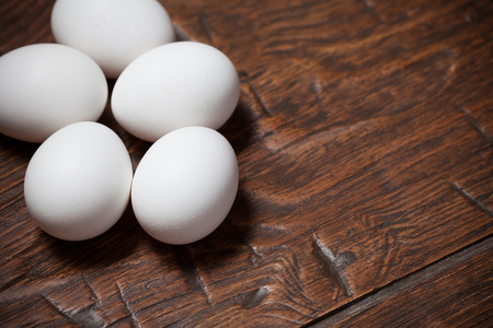 chicken farm: Fresh farm eggs on a wooden rustic table Stock Photo