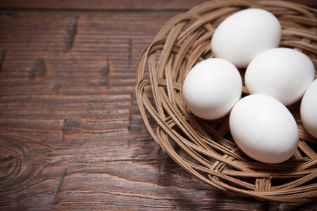 basket: Fresh farm eggs on a wooden rustic table Stock Photo