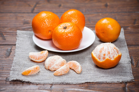 Tangerines on old wooden table photo