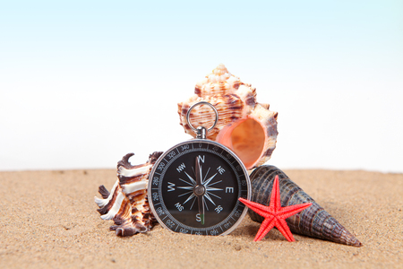 Compass, seashells on and starfish the sea sand and place for text Stock Photo
