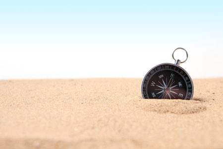Compass on the sea sand and place for text Stock Photo