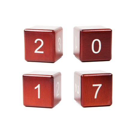 newyear: Wooden cubes with numbers isolated on white background. Concept new year 2017. Stock Photo