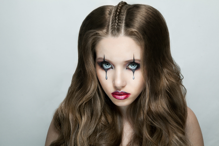 Woman with stylish fancy gothic Halloween makeup Stock Photo - 96834647