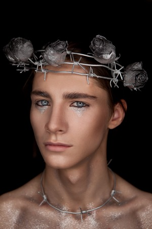 Portrete of fashion young man in the image of a martyr Stock Photo