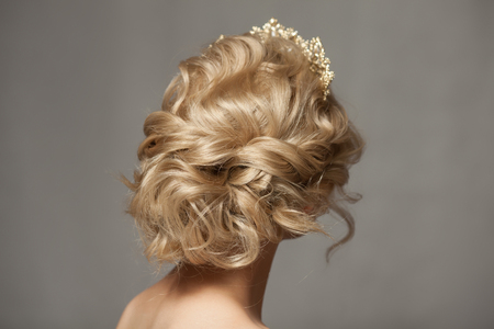 Beautiful blond girl in the image of a bride with a tiara in her hair. Banco de Imagens