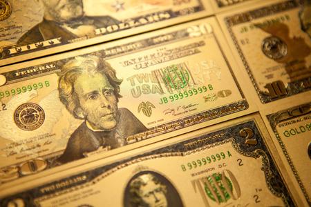 Currency US golden dollar banknotes close-up background. Banco de Imagens