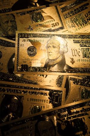 Currency US golden dollar banknotes close-up background. Stok Fotoğraf