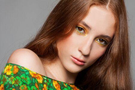 Beautiful redhead woman with stylish colorful makeup