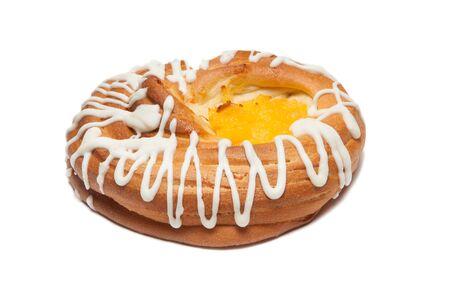 Bun with white glaze isolated on white background