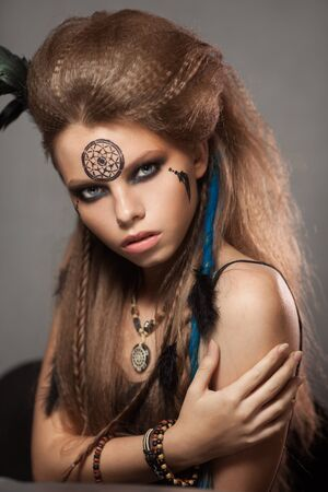 Closeup portrait of shamanic female with colorful makeup. 写真素材