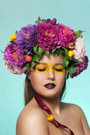 Beautiful brunette woman with flower wreath on her head.