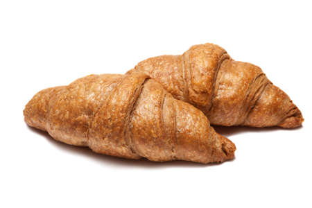 Two fresh french croissants isolated on white background
