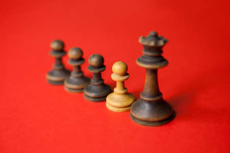 Business leader with his team with a spy in the team. Chess concept.