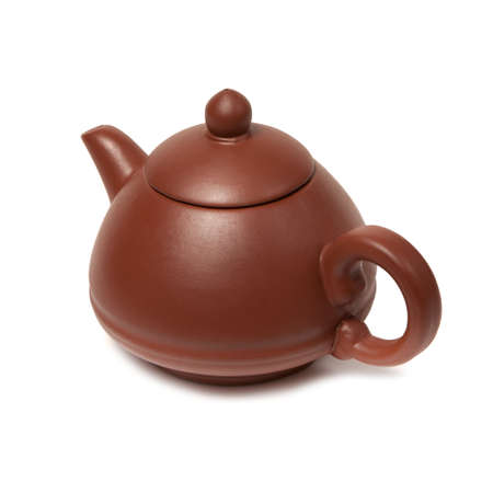 Old purple yixing clay Chinese teapot yuan zhu hu type for tea ceremony isolated on white