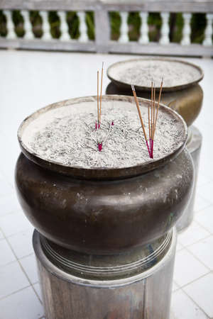 Incense sticks on joss stick pot are burning and smoke use for praying Buddha or Hindu gods to show respect, Burning aromatic incense sticks. for pay respect