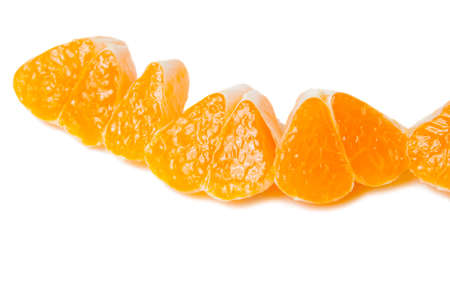 Tangerine slices with shadow isolated on white background. Stock Photo
