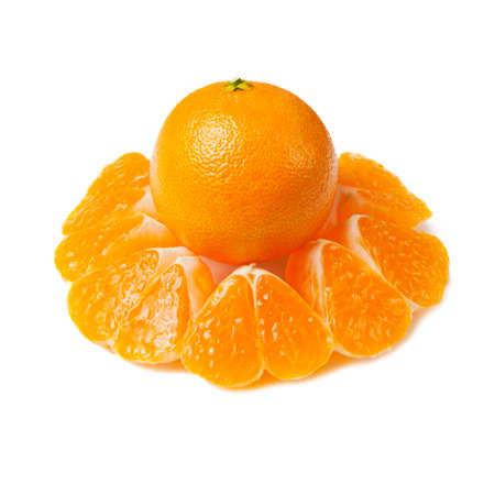 Ripe tangerine and slices isolated on white background.