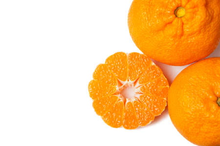 Ripe tangerines and slices isolated on white background with place for text.