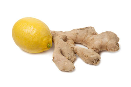 Close up of fresh ginger root spice and lemon isolated on white background. Stock Photo