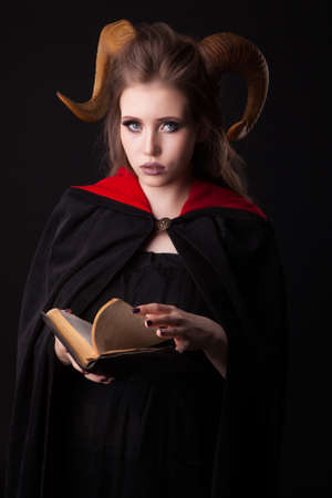 Portrait of an attractive demon woman with horns