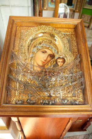 MOSCOW, RUSSIA - SEPTEMBER 26, 2018: icon of Mary the Mother of God with her son Jesus in a wooden frame.