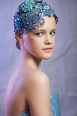 Girl in vintage style with blue lace on her head.
