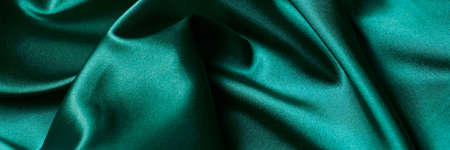 Abstract background luxury cloth or liquid wave or wavy folds of silk texture satin material. Green background for banner design. Stok Fotoğraf