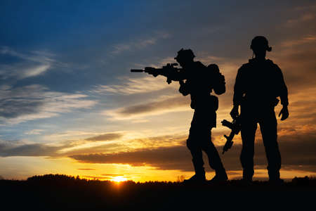 Silhouette of a soldiers against the sunrise. Concept - protection, patriotism, honor. Armed forces of Turkey, Israel, Egypt and other countries.