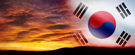 South Korea waving flag on the beautiful orange sunset background.