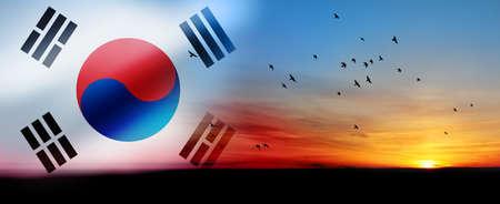 South Korea waving flag with birds on the beautiful orange sunset background.