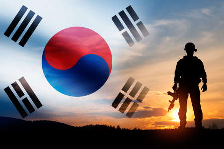 Silhouette of a soldiers against the sunrise. Concept - protection, patriotism, honor. Armed forces of South Korea. Standard-Bild