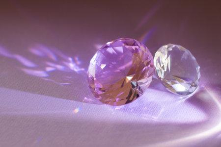 Purple precious gemstones for design gems jewelery. Big diamonds crystal on purple background.